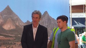Peter Capaldi with scenery backdrop of mountains and desert.