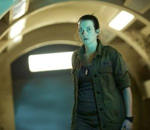 Sophie Stone as Cass, base leader in Under the Lake/Before the Flood.